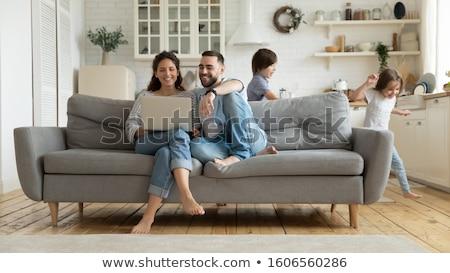 joven · mentiras · sofá · foto · sonriendo - foto stock © deandrobot