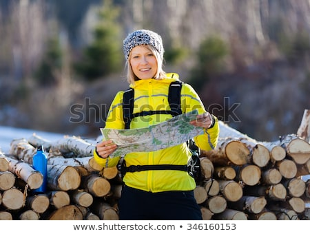 Hiking woman with backpack looking at camera in inspirational au Stock photo © blasbike