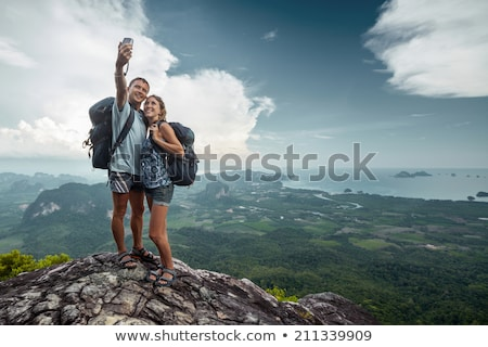 climber taking picture on mountain peak Stock photo © IS2
