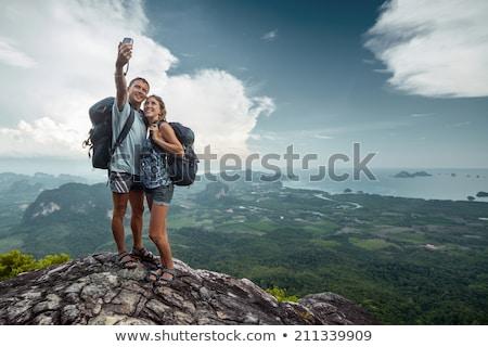 Stock photo: climber taking picture on mountain peak