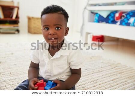 Fiú kisgyerek mosolyog kamerába portré Stock fotó © IS2