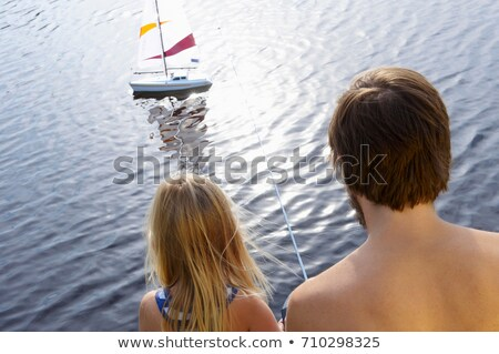 father and daughter with rc boat on lake stock photo © is2