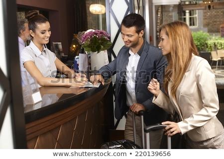 Európai hotel recepció asztal vállalati üzletemberek Stock fotó © studioworkstock