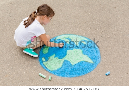 Girl drawing planet earth Stock photo © IS2