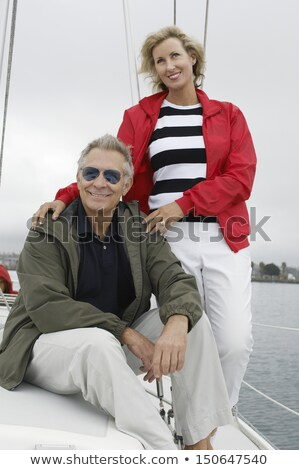 Mature woman standing on yacht Stock photo © IS2