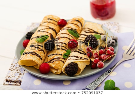 Chocolate crepes with blackberries Stock photo © YuliyaGontar