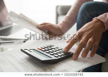 Worker Doing Calculations on Calculator, Project Stock photo © robuart