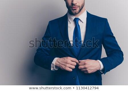 elegant man wearing a blue tuxedo holding hands stock photo © feedough