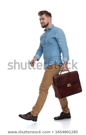 curious smart casual man holding suitcase looks to side Stock photo © feedough