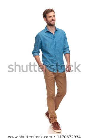 side view of smiling man stepping with hand in pocket Stock photo © feedough