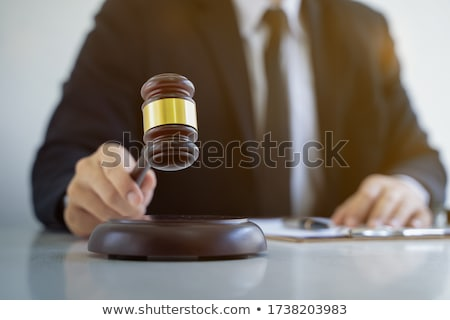 Male Judge Hand's Holding Mallet And Sound Block Stock photo © AndreyPopov