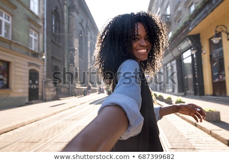 african young woman walking outdoors looking camera stock photo © deandrobot