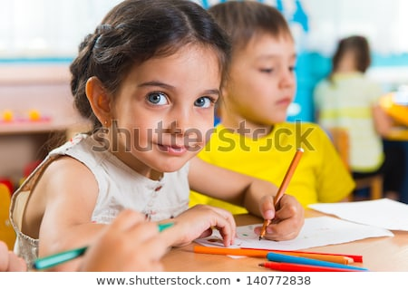 the cute preschoolers group in kindergarten together read a book stock photo © lopolo