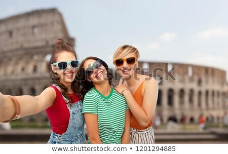 happy female friends taking selfie over coliseum Stock photo © dolgachov