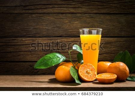 Still life verre fraîches jus d'orange vintage table en bois Photo stock © galitskaya