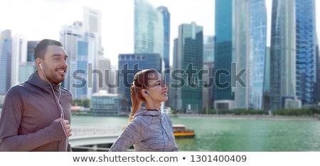 happy young man running over singapore city Stock photo © dolgachov
