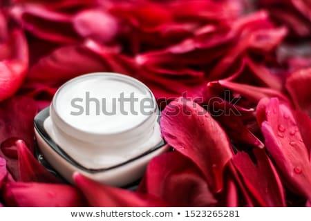 Sensitive skincare moisturizer cream on red flower petals and wa Stock photo © Anneleven