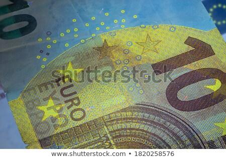 Diez euros billetes luz dinero Foto stock © DenisMArt