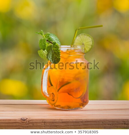 Cool cocktail with ice, lemon and tube Stock photo © foxbiz