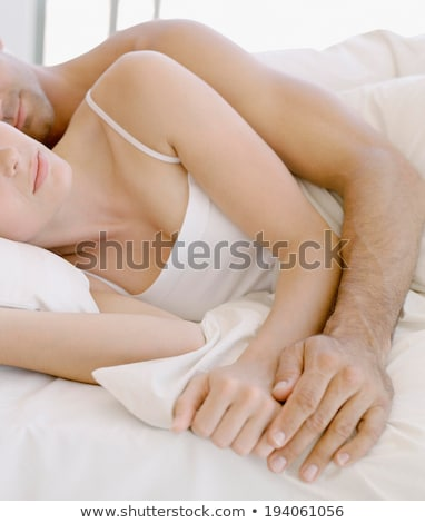 Woman sleeping on her husband's chest Stock photo © photography33