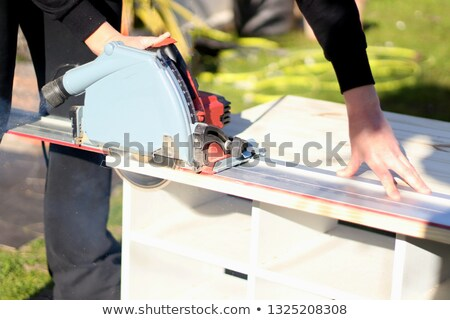 Woman holding circular saw Stock photo © photography33