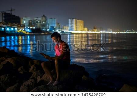 portré · szeszélyes · fiatalember · közelkép · izolált · fekete - stock fotó © photography33