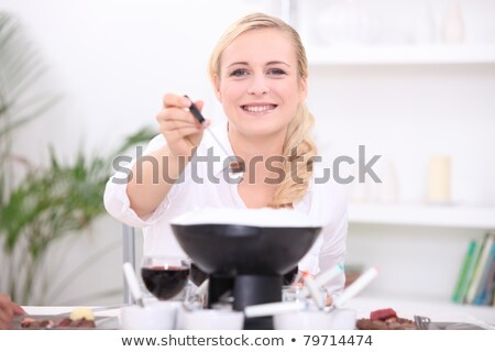 Woman having a fondue bourguignonne Stock photo © photography33