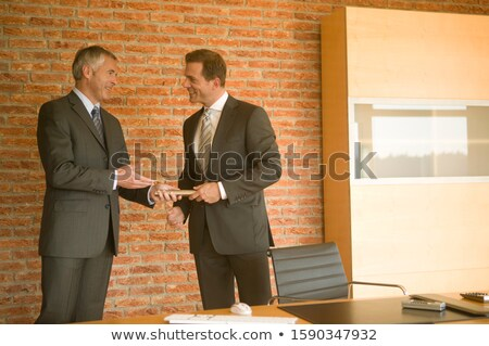 Businessmen passing the baton Stock photo © photography33