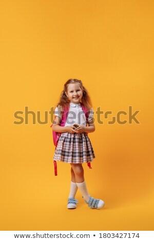 cute · schoolmeisje · poseren · zak · klas · meisje - stockfoto © stockyimages