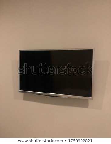 Tv Screen Mounted On Paper Wall Stock photo © albund