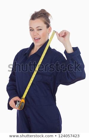 Female tecnician holding measuring tape as she winks stock photo © wavebreak_media