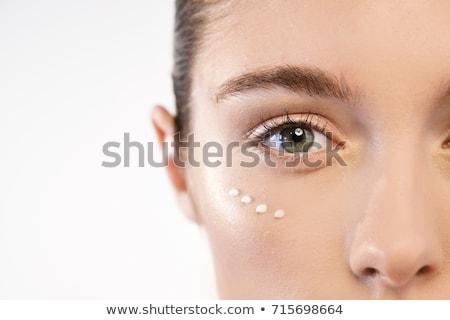 Close-up portrait of young woman applying lipgloss Stock photo © wavebreak_media