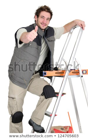 Tiler climbing ladder whilst giving the thumbs-up Stock photo © photography33