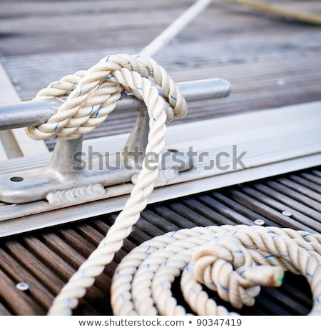 Mooring rope tied around steel anchor Stock photo © brebca