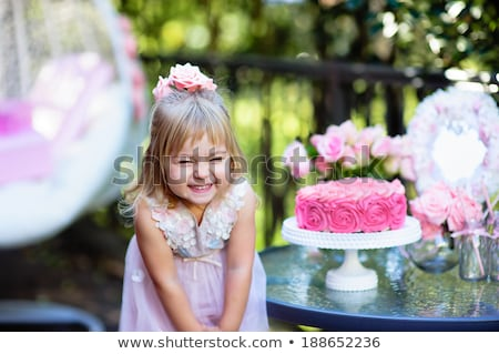 portrait of toddler girl with a cake stock photo © phbcz