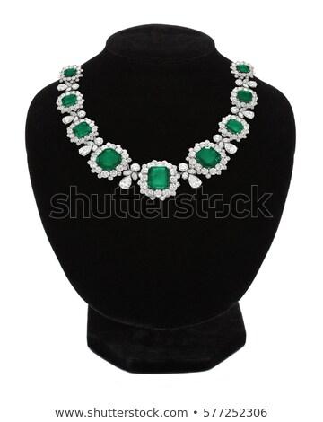 Pendant with green gem stones on black mannequin isolated on whi Stock photo © tetkoren