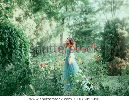beautiful woman and background full of roses stock photo © dolgachov