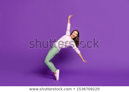 Smiling woman balancing on her toes Stock photo © dash