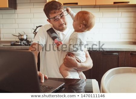 man working from home and take care of baby stock photo © dotshock