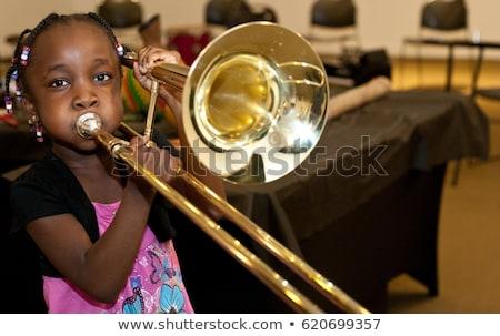 Young Female Musician Playing Trombone Stock photo © courtyardpix