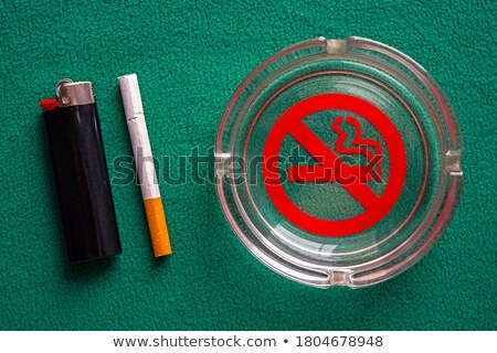 Danger warning signs on the black glass table Stock photo © CaptureLight
