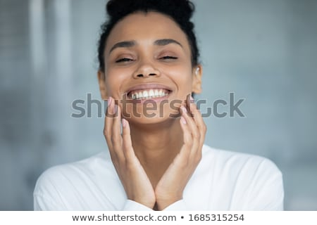 Gorgeous Woman Touching Facing with One Hand Stock photo © dash
