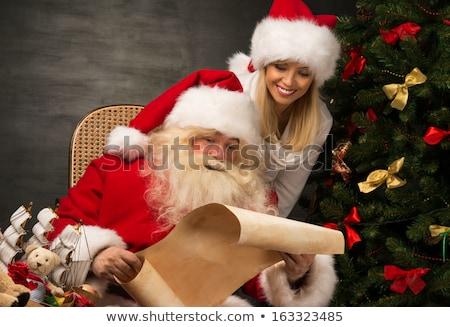 christmas woman hold big old roll stock photo © hasloo