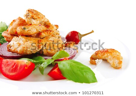 Sliced roasted meat with slices of lemon  Stock photo © OleksandrO