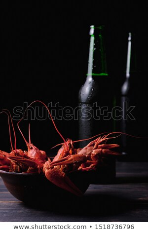 beer in a glass bottle and crayfish close-up  Stock photo © OleksandrO