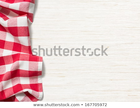 Red checkered tablecloth on a white wooden background Stock photo © Zerbor
