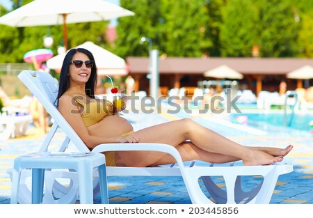 young attractive smiling pregnant woman relaxing by swimming poo Stock photo © Victoria_Andreas