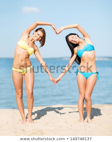 Shapely young woman in a bikini at the beach Stock photo © dash