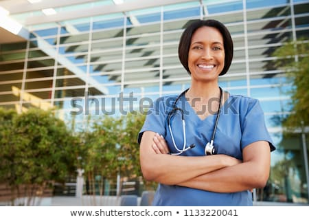 A nurse in front of the hospital Stock photo © bluering