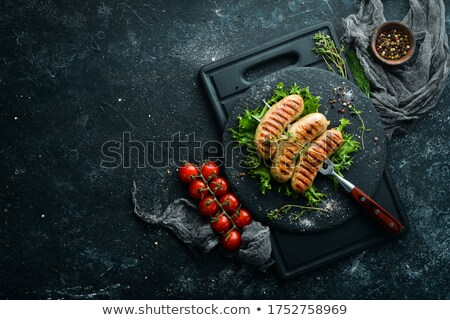 Stock photo: Smoked pork on fork